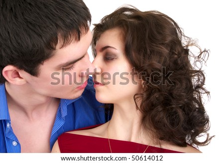 Portrait of kissing beautiful sexual couple isolated over white background - stock photo