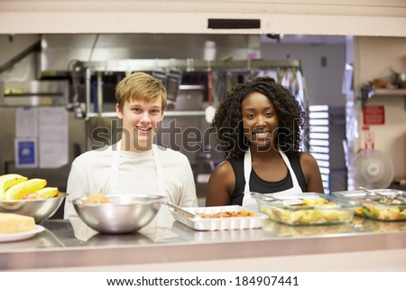 Portrait Of Kitchen Staff In Homeless Shelter - stock photo