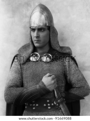 Portrait of knight in armor - stock photo
