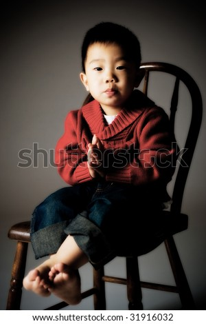 Portrait of Korean Boy. Hands folded in prayerful gesture