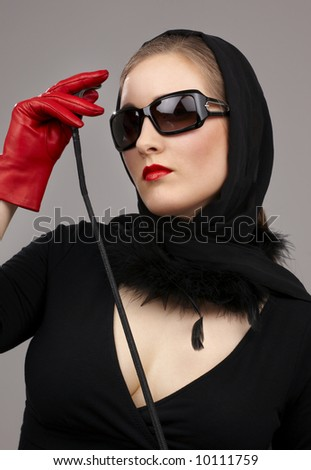 portrait of lady in black headscarf and red gloves with crop - stock photo