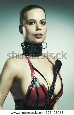 Portrait of lady in latex apparel - stock photo