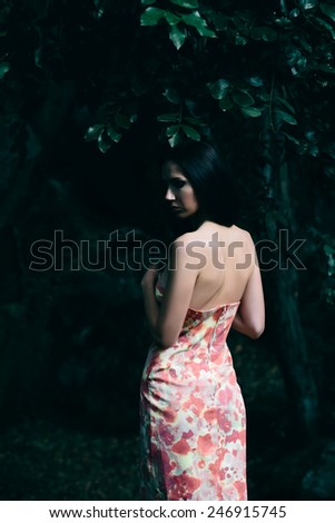 Portrait of lady in the dress with floral pattern in the Vorontsov Park