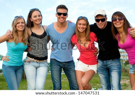 portrait of large group of young people in summer time - stock photo