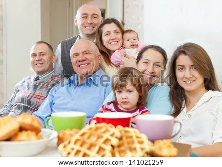 Portrait of large happy multigeneration family having tea at home - stock photo