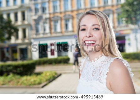 portrait of laughing business woman in city with copy space