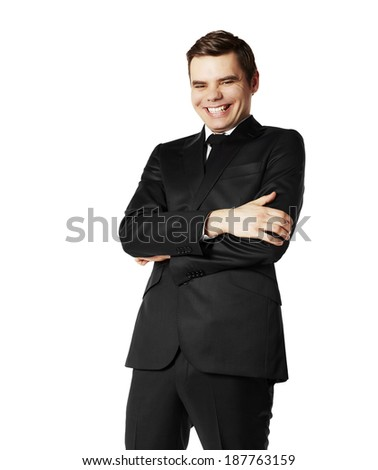Portrait of laughing businessman in black suit.
