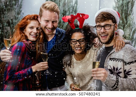 Portrait of laughing friends enjoying Xmas