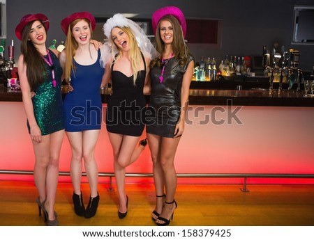 Portrait of laughing friends having a hen party looking at camera - stock photo