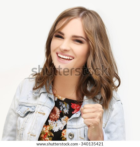 Portrait of laughing girl gesturing. - stock photo