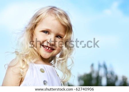 portrait of laughing little girl outdoor - stock photo