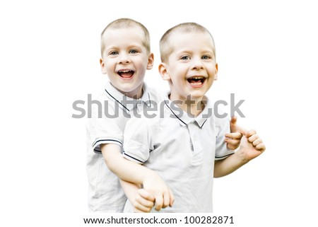 Portrait of laughing twins isolated on white happy together - stock photo
