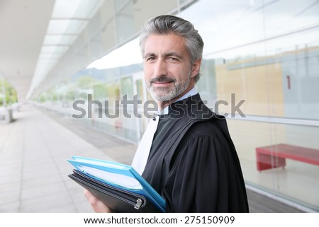 Portrait of lawyer standing outside courthouse building - stock photo