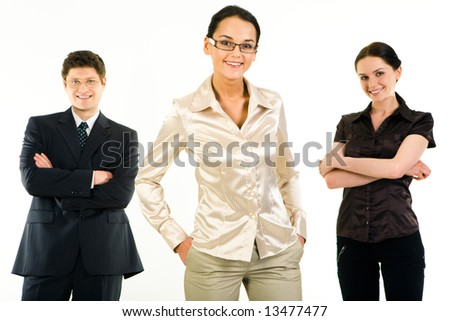 Portrait of leading woman looking at camera on the background of her business team - stock photo