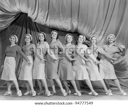 Portrait of line of female dancers on stage