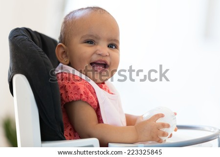 Portrait of little African American little girl holding her milk bottle - Black people - stock photo