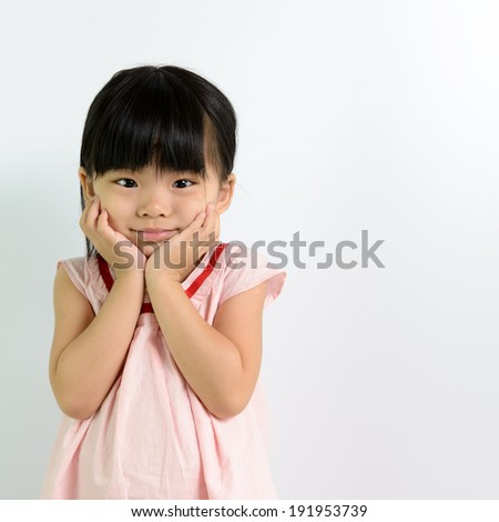 Portrait of little Asian child on white background