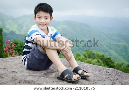 Portrait of little asian cute boy with Mountains view in thailand .  - stock photo