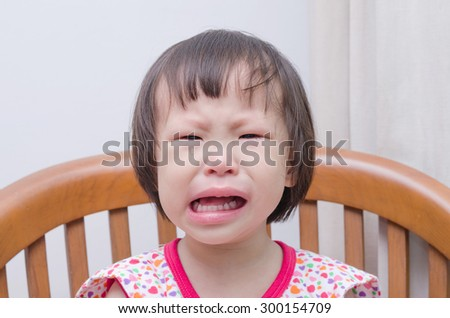Portrait of little Asian girl crying  - stock photo