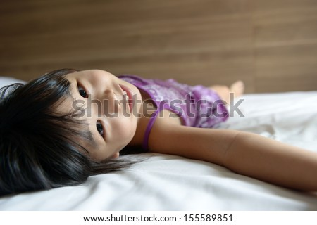 beautiful woman lying down on her stock photo 357491927 shutterstock. Black Bedroom Furniture Sets. Home Design Ideas