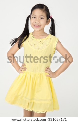 Portrait of Little asian girl with smiles face ,isolated on gray background
