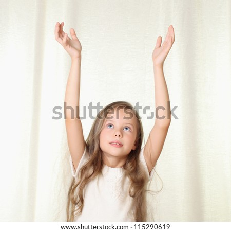 Portrait of little blond girl with hans rised up - stock photo