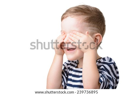 Portrait of little boy closed eyes with his hands, studio shot - stock photo