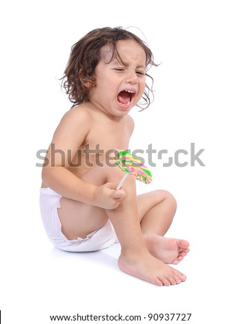 Portrait of little boy crying hold a candy isolated on white background - stock photo