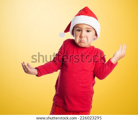 portrait of little boy doubtfully at Christmas - stock photo