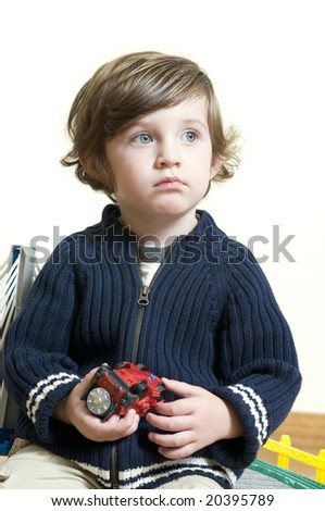 portrait of little boy dreaming. Shallow DOF. - stock photo