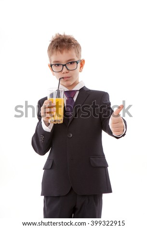 Portrait of little boy drinking orange juice. Isolated on white background.
