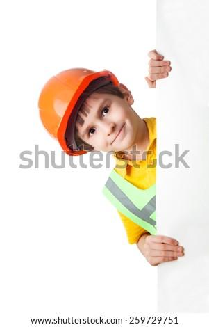 Portrait of little boy in hardhat with billboard - stock photo