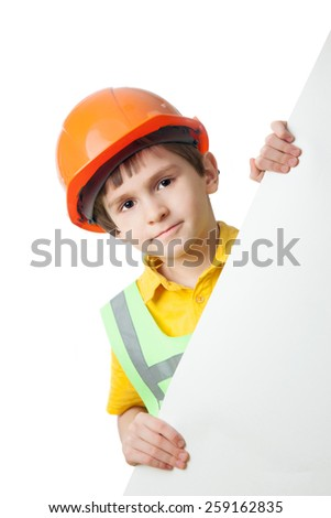 Portrait of little boy in hardhat with billboard, isolated on white background - stock photo