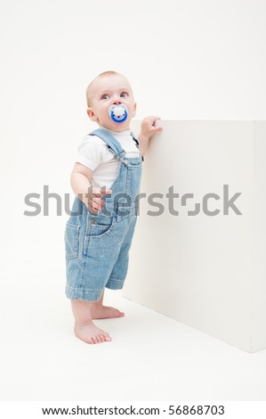 portrait of little boy in jean dungarees - stock photo