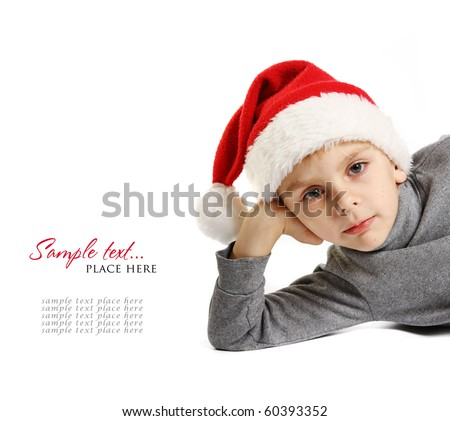 Portrait of little boy in santa hat on white background