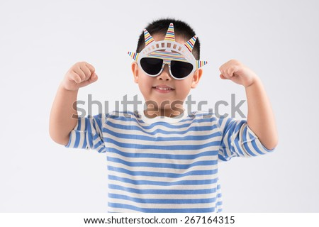 Portrait of little boy in Statue of Liberty sunglasses