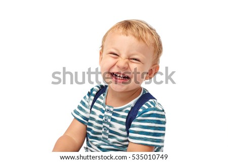 Portrait of little boy laughing, isolated on white