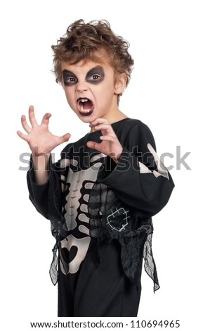 Portrait of little boy wearing halloween costume on white background - stock photo