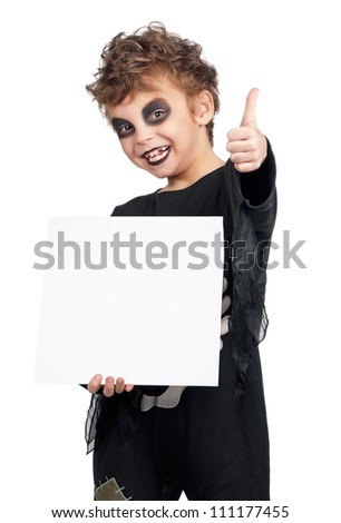 Portrait of little boy wearing halloween costume with empty white board on white background