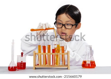 Portrait of little boy wearing lab coat and mixing the chemistry fluid, isolated over white - stock photo
