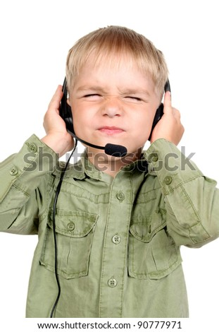 Portrait of little boy with headphones and microphone listening with closed eyes, isolated on white - stock photo