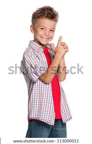 Portrait of little boy with imaginary gun isolated on white background