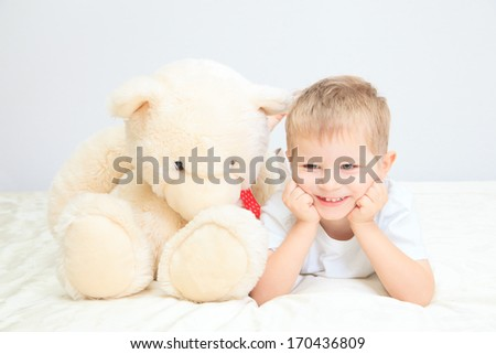 Portrait of little boy with teddy bear at home, home comfort and leisure