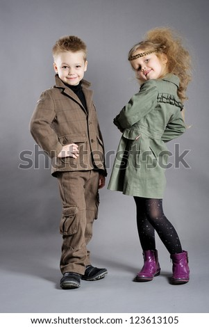portrait of little boys and girls in the studio - stock photo