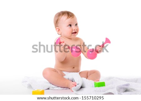 portrait of  little caucasian girl sitting with toys and blanket isolated on white background. baby 10 months