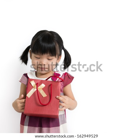 Portrait of little child with gift bag