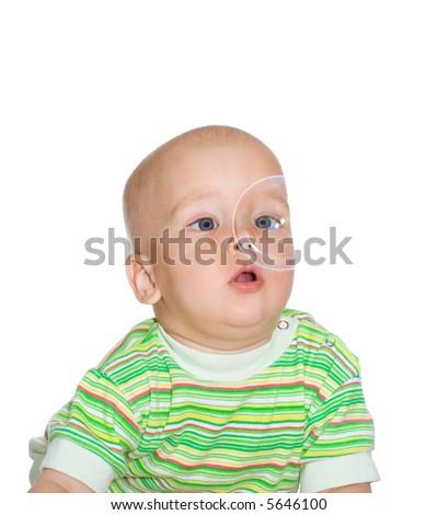 Portrait of little child with soap bubble - stock photo