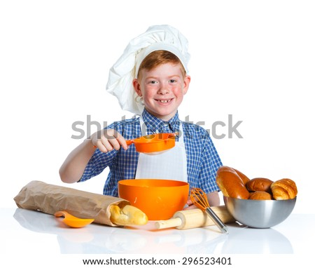 Portrait of Little Cook Making Bread. Isolated on white background. - stock photo