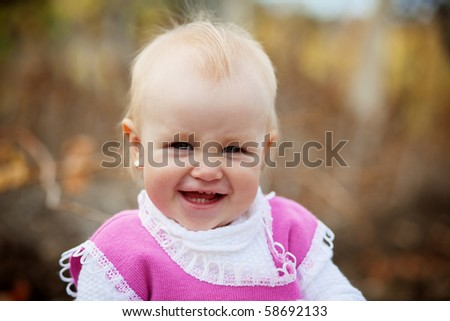 Portrait of little cute child in autumn - stock photo