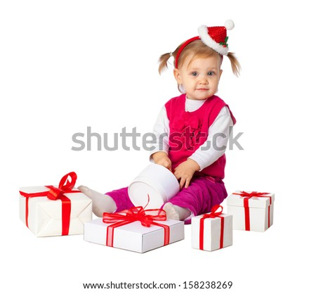 Portrait of little cute child in Christmas hat with gift